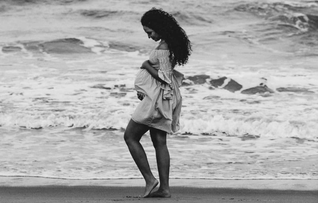 Pregnant Woman by ocean